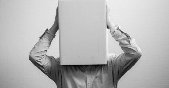 Man with box on head, no awareness