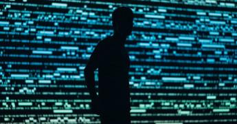 Voyeur, male silhouette over tech background