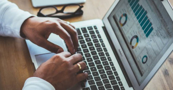 Analytics, Statistics, typing on laptop