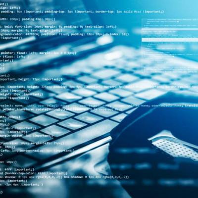 Hacker using laptop, code overlay image