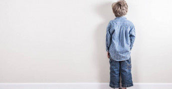 Punishment, boy facing the wall