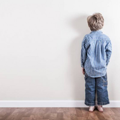 Punishment, boy facing the wall