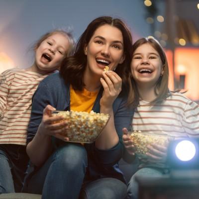 People watching TV eating popcorn