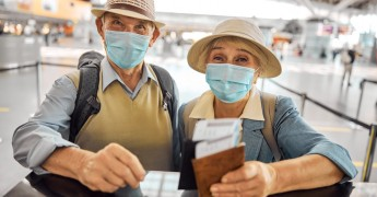 Airport travellers with masks