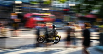 Blurred image of man on bycicle