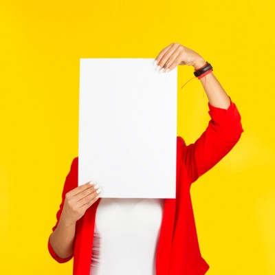 No advertising, woman holding blank card over face