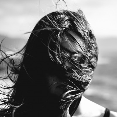 Girl, hair covering face